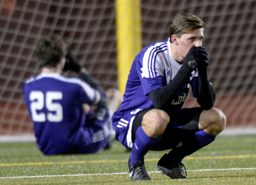 . Boulder High School\'s Mitchell Davis, right, and Rayn Bower show their emotions after losing a semi-final game against Pine Creek High School on Wednesday, Nov. 6, at Cherokee Trail High School in Aurora. Boulder lost the game 1-0. For more photos of the game go to www.dailycamera.com Jeremy Papasso/ Camera