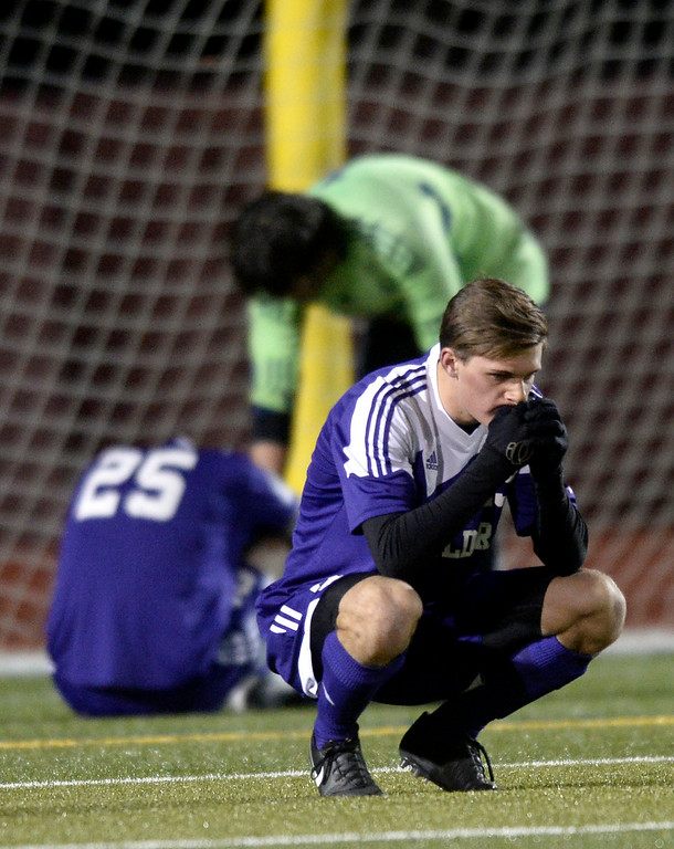 . Boulder High School\'s Mitchell Davis, at front, shows his emotions as goalkeeper Henry Huettel consoles Rayn Bower after losing a semi-final game against Pine Creek High School on Wednesday, Nov. 6, at Cherokee Trail High School in Aurora. Boulder lost the game 1-0. For more photos of the game go to www.dailycamera.com Jeremy Papasso/ Camera
