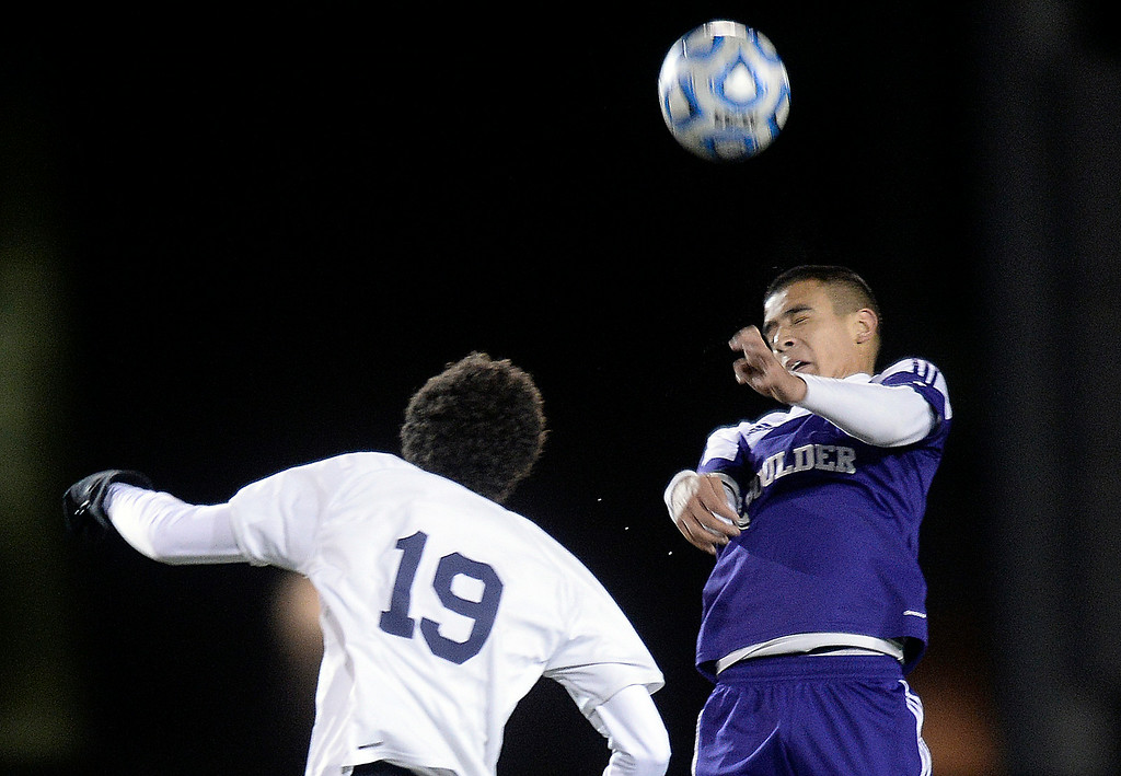 . Boulder High School\'s Javier Castruita heads the ball over Jay Morales during a semi-final game against Pine Creek High School on Wednesday, Nov. 6, at Cherokee Trail High School in Aurora. Boulder lost the game 1-0. For more photos of the game go to www.dailycamera.com Jeremy Papasso/ Camera