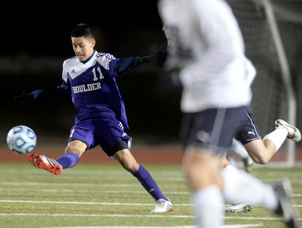 . Boulder High School\'s Brian Castruita passes the ball during a semi-final game against Pine Creek High School on Wednesday, Nov. 6, at Cherokee Trail High School in Aurora. Boulder lost the game 1-0. For more photos of the game go to www.dailycamera.com Jeremy Papasso/ Camera