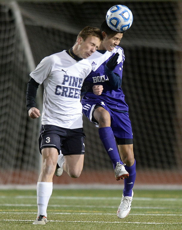 . Boulder High School\'s Brian Castruita heads the ball over Taylor Carroll during a semi-final game against Pine Creek High School on Wednesday, Nov. 6, at Cherokee Trail High School in Aurora. Boulder lost the game 1-0. For more photos of the game go to www.dailycamera.com Jeremy Papasso/ Camera
