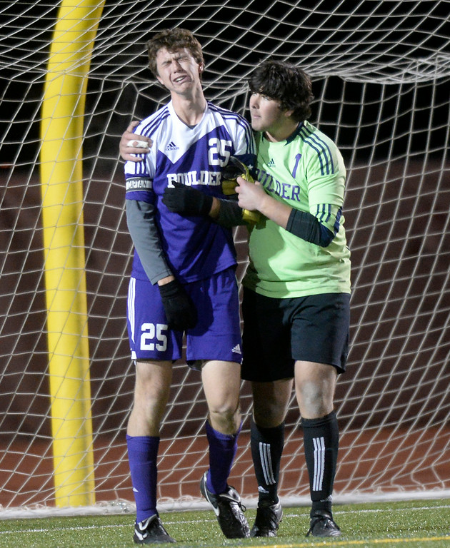 . Boulder High School goalkeeper tries to console Rayn Bower after losing a semi-final game against Pine Creek High School on Wednesday, Nov. 6, at Cherokee Trail High School in Aurora. Boulder lost the game 1-0. For more photos of the game go to www.dailycamera.com Jeremy Papasso/ Camera