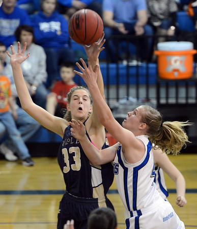 "Callie Kaiser of Broomfield drives to the basket against Emily Dryden of Mullen.<br /> For more photos of the game, go to  <a href=""http://www.dailycamera.com"">http://www.dailycamera.com</a>.<br /> Cliff Grassmick / March 2, 2013"