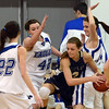 "Jessie Sienkiewicz of Mullen is trapped by Stacie Hull (42) and Meghan Stovall, both of Broomfield.<br /> For more photos of the game, go to  <a href=""http://www.dailycamera.com"">http://www.dailycamera.com</a>.<br /> Cliff Grassmick / March 2, 2013"