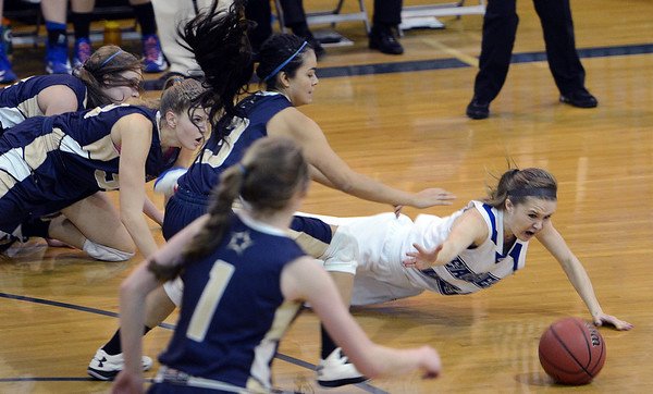 "Cherokee Rohrbaugh of Broomfield goes to the floor in front of several Mullen players.<br /> For more photos of the game, go to  <a href=""http://www.dailycamera.com"">http://www.dailycamera.com</a>.<br /> Cliff Grassmick / March 2, 2013"