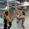 "Stacie Hull of Broomfield shoots over Emily Dryden of Mullen.<br /> For more photos of the game, go to  <a href=""http://www.dailycamera.com"">http://www.dailycamera.com</a>.<br /> Cliff Grassmick / March 2, 2013"