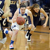 "Bri Wilber of Broomfield looks for an outlet pass against Mullen.<br /> For more photos of the game, go to  <a href=""http://www.dailycamera.com"">http://www.dailycamera.com</a>.<br /> Cliff Grassmick / March 2, 2013"
