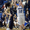 "Bri Wilber of Broomfield shoots over Amanda Diaz of Mullen.<br /> For more photos of the game, go to  <a href=""http://www.dailycamera.com"">http://www.dailycamera.com</a>.<br /> Cliff Grassmick / March 2, 2013"