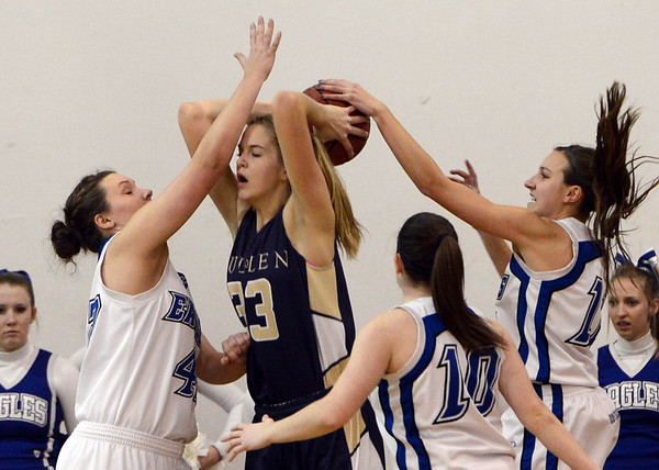 "Emily Dryden (33) of Mullen is pressured by Stacie Hull, left, and Katie Croell, both of Broomfield.<br /> For more photos of the game, go to  <a href=""http://www.dailycamera.com"">http://www.dailycamera.com</a>.<br /> Cliff Grassmick / March 2, 2013"