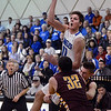 "Spenser Reeb of Broomfield throws up a shot to beat the clock against Windsor.<br /> For more photos of the game, go to  <a href=""http://www.dailycamera.com"">http://www.dailycamera.com</a>.<br /> Cliff Grassmick / March 2, 2013"