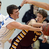 "Evan Kihn of Broomfield pressures Tanner Bohm of Windsor High.<br /> For more photos of the game, go to  <a href=""http://www.dailycamera.com"">http://www.dailycamera.com</a>.<br /> Cliff Grassmick / March 2, 2013"
