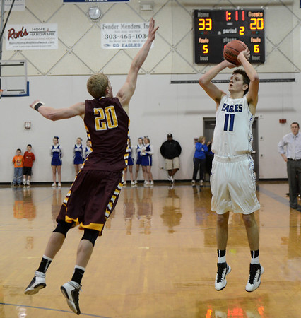 "Spenser Reeb of Broomfield  shoots over  Dalton Walker of Windsor.<br /> For more photos of the game, go to  <a href=""http://www.dailycamera.com"">http://www.dailycamera.com</a>.<br /> Cliff Grassmick / March 2, 2013"