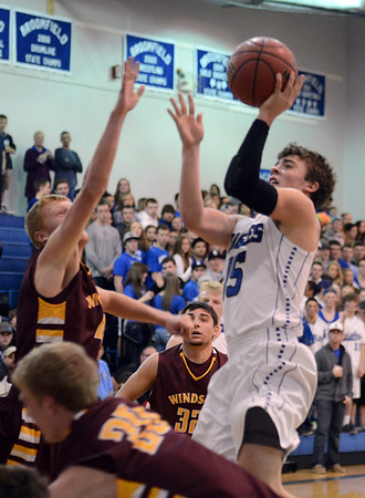 "Evan Kihn of Broomfield drives to the basket on Dylan Ochsner of Windsor High.<br /> For more photos of the game, go to  <a href=""http://www.dailycamera.com"">http://www.dailycamera.com</a>.<br /> Cliff Grassmick / March 2, 2013"