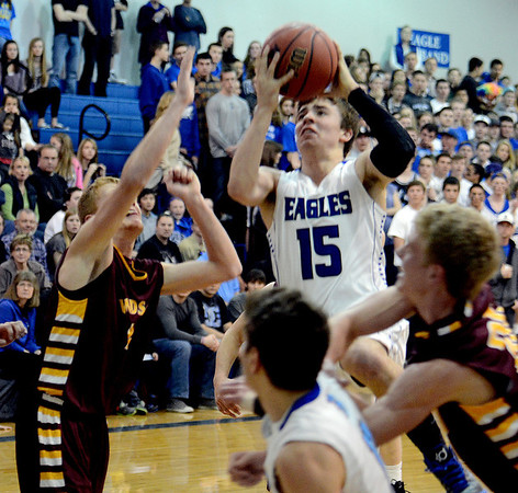 """Evan Kihn of Broomfield drives to the basket on Dylan Ochsner of Windsor High.<br /> For more photos of the game, go to  <a href=""""http://www.dailycamera.com"""">http://www.dailycamera.com</a>.<br /> Cliff Grassmick / March 2, 2013"""