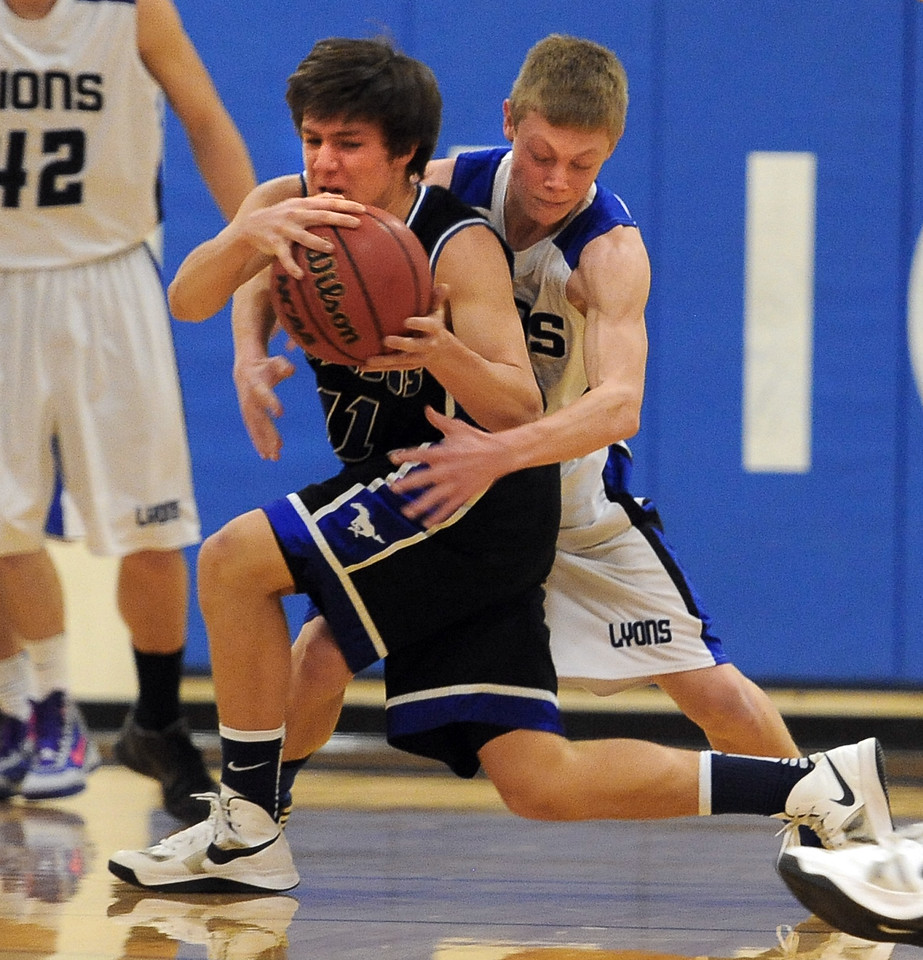 """Cam Conner of Dawson, tries to keep the ball from Trent Poulsen of Lyons on Saturday.<br /> For more photos of the game go to  <a href=""""http://www.dailycamera.com"""">http://www.dailycamera.com</a>.<br /> Cliff Grassmick / January 26, 2013"""