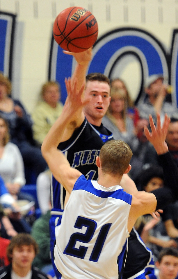 """Robby Keown of Dawson gets a pass over Justin Bolt of Lyons.<br /> For more photos of the game go to  <a href=""""http://www.dailycamera.com"""">http://www.dailycamera.com</a>.<br /> Cliff Grassmick / January 26, 2013"""