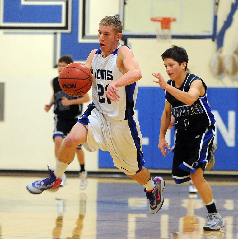 """Justin Boldt of Lyons gets out the the break in front of Skyler DaPuzzo of Dawson.<br /> For more photos of the game go to  <a href=""""http://www.dailycamera.com"""">http://www.dailycamera.com</a>.<br /> Cliff Grassmick / January 26, 2013"""