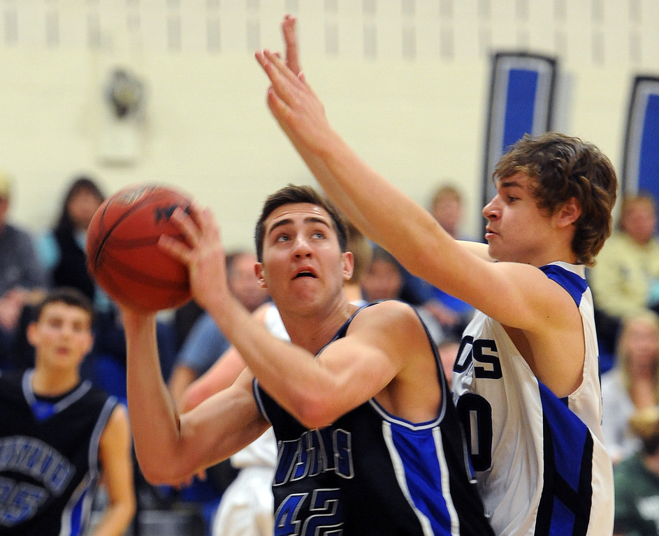 """Shawn O'Grady of Dawson looks to shoot over Macrae Falce  of Lyons on Saturday.<br /> For more photos of the game go to  <a href=""""http://www.dailycamera.com"""">http://www.dailycamera.com</a>.<br /> Cliff Grassmick / January 26, 2013"""