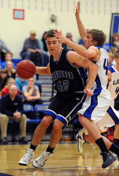 "Shawn O'Grady of Dawson drives around Ryan Boucher of Lyons on Saturday.<br /> For more photos of the game go to  <a href=""http://www.dailycamera.com"">http://www.dailycamera.com</a>.<br /> Cliff Grassmick / January 26, 2013"
