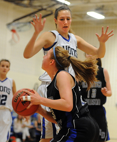 "Fiona Bell of Dawson tries to shoot over Olivia Raspotnik of Lyons on Saturday.<br /> For more photos of the game go to  <a href=""http://www.dailycamera.com"">http://www.dailycamera.com</a>.<br /> Cliff Grassmick / January 26, 2013"