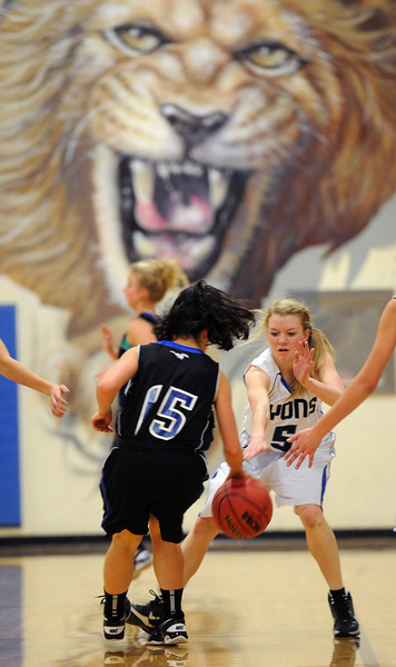 "Rachel Clair (15) of Dawson tries to get past Anna Sundrud of Lyons.<br /> For more photos of the game go to  <a href=""http://www.dailycamera.com"">http://www.dailycamera.com</a>.<br /> Cliff Grassmick / January 26, 2013"