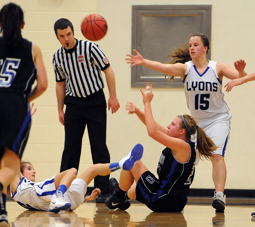 "Fiona Bell of Dawson, bottom right, gets a pass by Carla Walko (15) of Lyons.<br /> For more photos of the game go to  <a href=""http://www.dailycamera.com"">http://www.dailycamera.com</a>.<br /> Cliff Grassmick / January 26, 2013"