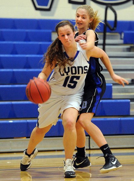 "Carla  Walko of Lyons drives past Emily Barrett of Dawson.<br /> For more photos of the game go to  <a href=""http://www.dailycamera.com"">http://www.dailycamera.com</a>.<br /> Cliff Grassmick / January 26, 2013"