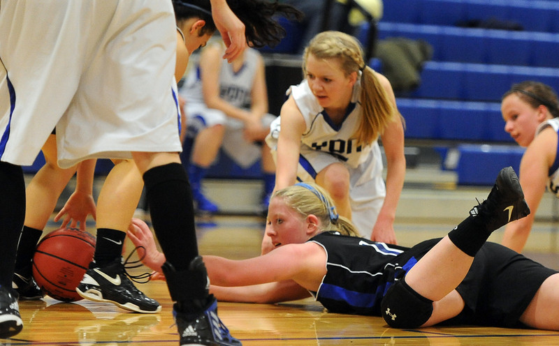 "Nicole Towner, bottom, of Dawson, reaches for a loose ball as Anna Sundrud of Lyons defends.<br /> For more photos of the game go to  <a href=""http://www.dailycamera.com"">http://www.dailycamera.com</a>.<br /> Cliff Grassmick / January 26, 2013"