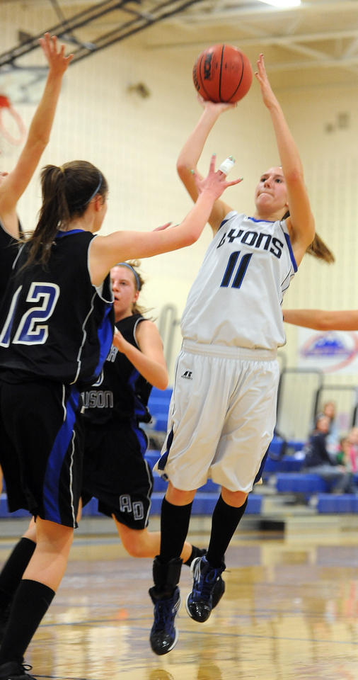 "Olivia Raspotnik of Lyons  pulls up to shoot over Lindsey Gallop of Dawson.<br /> For more photos of the game go to  <a href=""http://www.dailycamera.com"">http://www.dailycamera.com</a>.<br /> Cliff Grassmick / January 26, 2013"