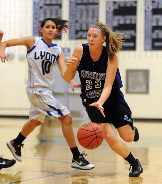 "Fiona Bell of Dawson drives past Sammy Bashor of Lyons on Saturday.<br /> For more photos of the game go to  <a href=""http://www.dailycamera.com"">http://www.dailycamera.com</a>.<br /> Cliff Grassmick / January 26, 2013"