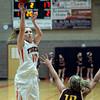 "Erie High School's Amanda Ochoa sinks a three-pointer over Ashlee Lemos during a game against Windsor on Tuesday, Feb. 19, at Erie High School. Windsor won the game 48-42. For more photos of the game go to  <a href=""http://www.dailycamera.com"">http://www.dailycamera.com</a><br /> Jeremy Papasso/ Camera"