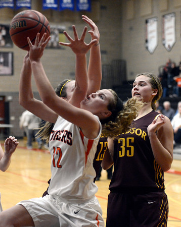 "Erie High School's Kenzie Kudrna goes for a shot in front of Brooke Pemberton, No. 35, during a game against Windsor on Tuesday, Feb. 19, at Erie High School. Windsor won the game 48-42. For more photos of the game go to  <a href=""http://www.dailycamera.com"">http://www.dailycamera.com</a><br /> Jeremy Papasso/ Camera"