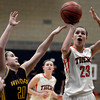 "Erie High School's Serena Gudino takes a shot over Alysa Manicone during a game against Windsor on Tuesday, Feb. 19, at Erie High School. Windsor won the game 48-42. For more photos of the game go to  <a href=""http://www.dailycamera.com"">http://www.dailycamera.com</a><br /> Jeremy Papasso/ Camera"