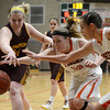 "Erie High School's Piper Zeier, center, and Serena Gudino fight for a loose ball with Korbyn Ukasick, at right, during a game against Windsor on Tuesday, Feb. 19, at Erie High School. Windsor won the game 48-42. For more photos of the game go to  <a href=""http://www.dailycamera.com"">http://www.dailycamera.com</a><br /> Jeremy Papasso/ Camera"