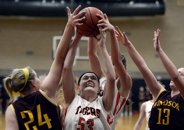 "Erie High School's Piper Zeier fights for a rebound with Korbyn Ukasick, left, and Maggie Griggs, at right, during a game against Windsor on Tuesday, Feb. 19, at Erie High School. Windsor won the game 48-42. For more photos of the game go to  <a href=""http://www.dailycamera.com"">http://www.dailycamera.com</a><br /> Jeremy Papasso/ Camera"