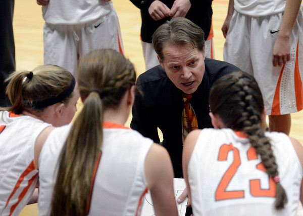 "Erie High School Head Coach Noel Potter talks with his team during a game against Windsor on Tuesday, Feb. 19, at Erie High School. Windsor won the game 48-42. For more photos of the game go to  <a href=""http://www.dailycamera.com"">http://www.dailycamera.com</a><br /> Jeremy Papasso/ Camera"
