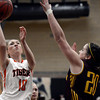 "Erie High School's Amanda Ochoa takes a shot over Alysa Manicone during a game against Windsor on Tuesday, Feb. 19, at Erie High School. Windsor won the game 48-42. For more photos of the game go to  <a href=""http://www.dailycamera.com"">http://www.dailycamera.com</a><br /> Jeremy Papasso/ Camera"