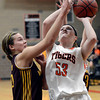 "Erie High School's Piper Zeier takes a shot over Brooke Pemberton during a game against Windsor on Tuesday, Feb. 19, at Erie High School. Windsor won the game 48-42. For more photos of the game go to  <a href=""http://www.dailycamera.com"">http://www.dailycamera.com</a><br /> Jeremy Papasso/ Camera"