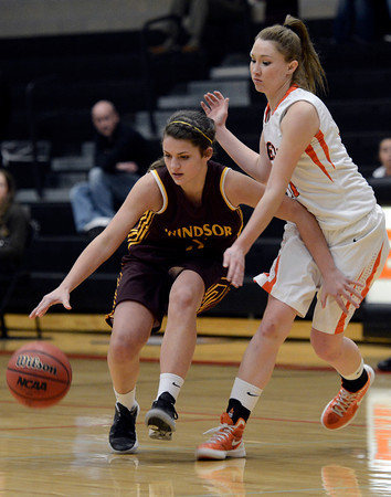 """Erie High School's Amanda Ochoa plays defense on Sophie Griggs during a game against Windsor on Tuesday, Feb. 19, at Erie High School. Windsor won the game 48-42. For more photos of the game go to  <a href=""""http://www.dailycamera.com"""">http://www.dailycamera.com</a><br /> Jeremy Papasso/ Camera"""