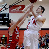 "Austin Parks , of Fairview, shoots over Matt Love of Liberty on Saturday.<br /> For more photos of the game, go to  <a href=""http://www.dailycamera.com"">http://www.dailycamera.com</a>.<br />  Cliff Grassmick  / March 2, 2013"