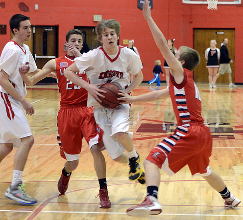 "Brent Wrapp of Fairview, drives between Matt Love (23) and AJ Bohuslavsky, both of Liberty.<br /> For more photos of the game, go to  <a href=""http://www.dailycamera.com"">http://www.dailycamera.com</a>.<br />  Cliff Grassmick  / March 2, 2013"