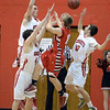 "AJ Bohuslavsky of Liberty is surround by Gabe Tierney, bottom left, Austin Sparks and Trevor McQueeney, all of Fairview.<br /> For more photos of the game, go to  <a href=""http://www.dailycamera.com"">http://www.dailycamera.com</a>.<br />  Cliff Grassmick  / March 2, 2013"