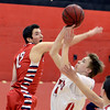 "Dakota Pilkington of Fairview shoots past Caden Nixon of Liberty.<br /> For more photos of the game, go to  <a href=""http://www.dailycamera.com"">http://www.dailycamera.com</a>.<br />  Cliff Grassmick  / March 2, 2013"