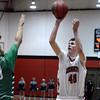 "Fairview High School's Miles MacKenzie takes a shot in front of Keelan Hammonds during a game against ThunderRidge High School on Wednesday, March 6, at Fairview High School in Boulder. For more photos of the game go to  <a href=""http://www.dailycamera.com"">http://www.dailycamera.com</a><br /> Jeremy Papasso/ Camera"