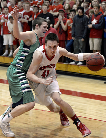 "Fairview High School's Austin Sparks drives to the hoop past Peter Howell during a game against ThunderRidge High School on Wednesday, March 6, at Fairview High School in Boulder. For more photos of the game go to  <a href=""http://www.dailycamera.com"">http://www.dailycamera.com</a><br /> Jeremy Papasso/ Camera"