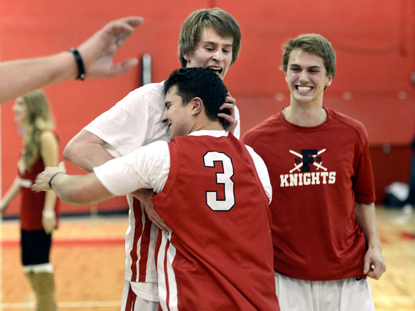 "Fairview High School's Brent Wrapp, back left, gets a hug from a fellow student after defeating ThunderRidge High School 55-52 on Wednesday, March 6, at Fairview High School in Boulder. For more photos of the game go to  <a href=""http://www.dailycamera.com"">http://www.dailycamera.com</a><br /> Jeremy Papasso/ Camera"