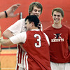 """Fairview High School's Brent Wrapp, back left, gets a hug from a fellow student after defeating ThunderRidge High School 55-52 on Wednesday, March 6, at Fairview High School in Boulder. For more photos of the game go to  <a href=""""http://www.dailycamera.com"""">http://www.dailycamera.com</a><br /> Jeremy Papasso/ Camera"""