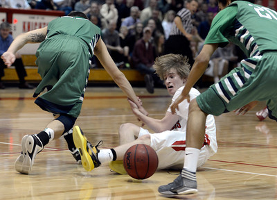 Fairview High School's Brent Wrapp fights for a loose ball with Hunter O'Neill, left, and Keelan Hammonds, at right, during a game against ThunderRidge High School on Wednesday, March 6, at Fairview High School in Boulder. For more photos of the game go to www.dailycamera.com Jeremy Papasso/ Camera