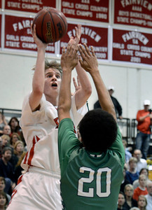 Fairview High School's Brent Wrapp takes a shot in front of Keelan Hammonds during a game against ThunderRidge High School on Wednesday, March 6, at Fairview High School in Boulder. For more photos of the game go to www.dailycamera.com Jeremy Papasso/ Camera