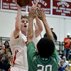 """Fairview High School's Brent Wrapp takes a shot in front of Keelan Hammonds during a game against ThunderRidge High School on Wednesday, March 6, at Fairview High School in Boulder. For more photos of the game go to  <a href=""""http://www.dailycamera.com"""">http://www.dailycamera.com</a><br /> Jeremy Papasso/ Camera"""